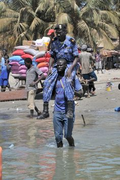 A primitive way to reach the boats to cross the river Gambia, but effective
