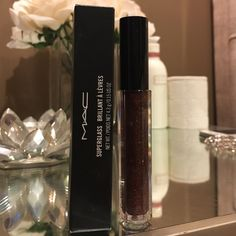 Mac Cosmetics Tunnel of Love Superglass Lipgloss Tunnel of Love super brilliant Lipgloss, so sparkly and shiny. I bought 3 of them because I was so in love. This one is a deep brown with shimmer. New in box. MAC Cosmetics Makeup Lip Balm & Gloss