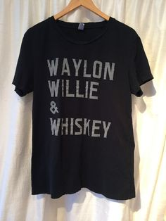 Talk about the perfect combination. 100% cotton black t shirt. Distressed along the neckline & hems. Unisex sizing. Fits dudes & babes. *please note there may be slight variations due to the distressi