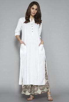 Here are the 9 best white kurti designs and patterns and let& try a different white kurta design to make a difference in your every day looks. Simple Kurti Designs, Salwar Designs, Kurta Designs Women, Kurti Designs Party Wear, Blouse Designs, Kurti Designs Pakistani, Plain Kurti Designs, Kurti Pakistani, Indian Designer Outfits