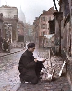 Young Artist at work in the Rue Norvins in Montmartre, Paris 1946. Photo by Edward Clark