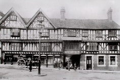 The Unicorn Inn, at the bottom of Wyle Cop, Shrewsbury, Shropshire.  A 17th Century structure, after the alterations of the 1880's when the right hand side was substantially rebuilt. In the 20th Century the first storey of the left side was completely removed to create a showroom.  The Unicorn Inn occupied a timber-framed building rebuilt c.1603. Shrewsbury Town, Shrewsbury Shropshire, 17th Century, Showroom, Britain, Unicorn, Victorian, Posters, Studio