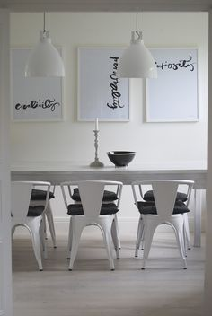 Simple art yet effective! You can do this yourself. Pick a font that will reflect the character of your space