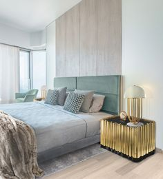 Bedroom ideas decor |  Nightstand made from wood finished covered by a tubular structure in gold plated brass. Interior contains one shelv and a drawer.