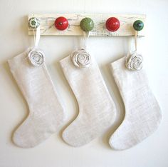 stocking hanger - wood plus cool knobs... such a nice idea