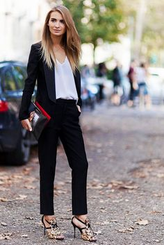 So simple and sexy in a silky camisole, black suit and leopard-print heels