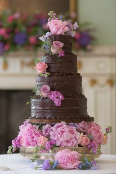 Four tier chocolate wedding cake decorated with fresh pastel coloured flowers | Photography http://juliemichaelsen.com/