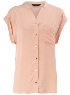 Peach sleeveless shirt. good for work.