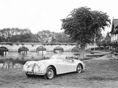 An old classic two sester would be ideal.  1954 Jaguar XK140 Open Two Seater
