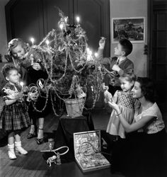 """.Grandma and Grandpa always had a """"funny little tree"""" that was definitely NOT purchased from the local a tree lot.  Mom says, he used to go chop an evergreen down on Christmas Eve, and when the kids woke on Christmas Day, it would be decorated in the living room...it was part of their Christmas present."""