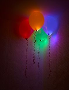 Glowsticks in balloons!  @Kristen Jackson - this could work at your reception too since you like the glowing thing!!