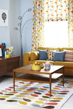 #MidCentury Modern -If I were totally redecorating, this would be the look I'd want! Love the blue and yellow. Happy rug!