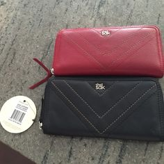 2 The Sak wallets black and red 2 The Sak wallets. Black one is brand new with tag and the red I used for a month or so. Style Jane leather wallets. Retail for $69 each The Sak Accessories