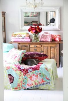 beautiful quilt colors...blue with pinks and lime green..rich purple...lovely