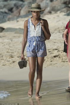 Loving the sunshine: Naomie Harris kicked back as she took a stroll on the beach in Barbados on Wednesday