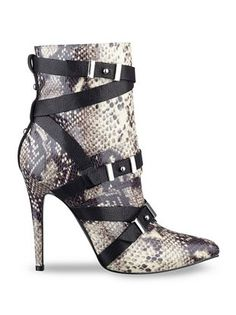 Love the snake-embossed details on these Guess booties.