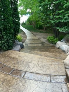 Stamped concrete pool deck with custom chiseled stone cantilevered coping by Sierra Concrete Arts