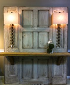I LOVE this piece! Made with old doors, salvage wood and iron railings made into sconces. We have this piece for sale and can ship anywhere. customerservice@Renaissanceconsignment.com Antique Doors, Old Doors, Front Door Plants, Interior Door Colors, Spa Room Decor, Old Door Knobs, Glass Pantry Door, Door Bar, Reclaimed Doors