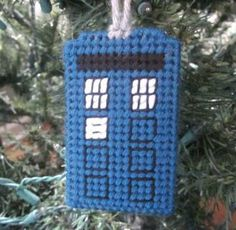 Doctor Who's TARDIS phone booth as a Christmas ornament in plastic canvas. I will have to make one of these for my daughter, a big Dr. Who fan! Plastic Canvas Ornaments, Plastic Canvas Christmas, Plastic Canvas Crafts, Plastic Canvas Patterns, Holiday Crafts, Holiday Fun, Christmas Holidays, Christmas Ornaments, Cross Stitch Embroidery