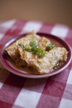 Braised bean curd rolls Ingredients: 4 ounces tofu skin 12 ounces ground pork 1 egg white 1 tablespoon minced or finely grated fresh ginger Kosher salt 1/4 teaspoon ground white pepper 1/2 teaspoon sugar 2 teaspoons light soy sauce 1 teaspoon oyster sauce 3 teaspoons cornstarch 3 dried shitakes, rehydrated and minced 1/4 cup low sodium canned or homemade chicken stock 2 cups oil vegetable or canola oil Cilantro or green onions