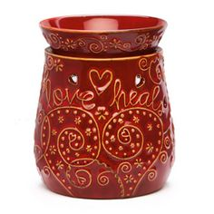 Our Love Heals charity warmer.  £7.50 from each one goes to Clic Sargent who help children and young people in the UK with cancer. £39 - www.ashleyangel.scentsy.co.uk