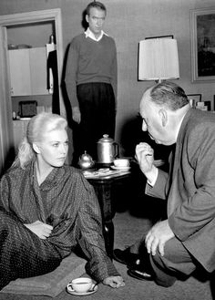 "Kim Novak, James Stewart and Alfred Hitchcock on the set of ""Vertigo"",1958. Her face."