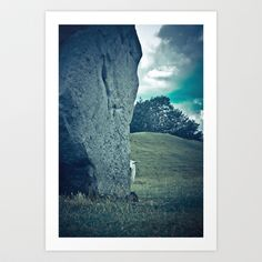 Sheep being coy with the photographer, peeking out from behind one of the ancient standing stones at Avebury, England.