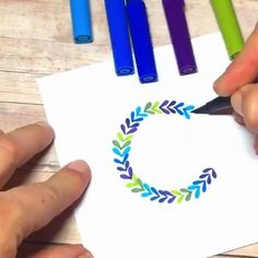 Hand lettering a wreath with multi colored pens Lettering Tutorial, Hand Lettering, Multi Color Pen, Calligraphy Drawing, Bullet Journal Inspo, Zentangle Patterns, Step By Step Drawing, Art World, Doodle Art