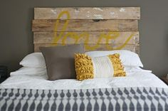 wooden painted bedhead grey mustard white bedroom. Love the mix of masculine and feminine elements.