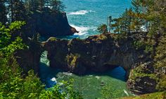 Samuel H Boardman state scenic corridor, Oregon coast.  12.6 miles of trail that at times goes along cliff-hugged beaches, then spans the headlands, crossing the Thomas Creek bridge, at 105m the highest in Oregon. Numerous points along US 101 offer access to short hikes, though it is entirely possible to backpack the entire route.  Photograph: Alamy