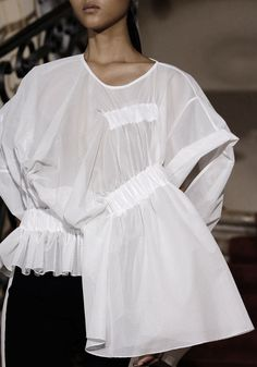 White shirt reinvented with an innovative cut; sporty fashion details // Viktor & Rolf Spring 2015