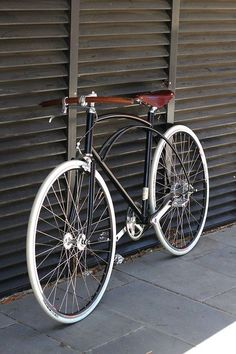 Vintage cruiser with leather grips and seat. Love the white tires too!: