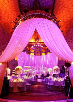 Pink and red tented reception. Wow