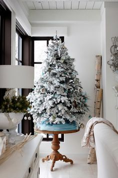 Vintage-White Christmas Decorating. Got to include a flocked tree in my décor this year
