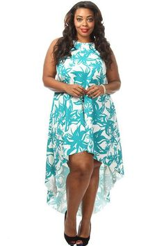 2bc2b61300 This plus size dress will get you looking fresh for summer! It features a  floral print body, and a flared high low bottom. Soft, stretch material  Loose fit ...