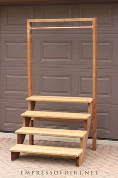 How to build a staircase plant stand for your garden. Use these building plans to make a whimsical staircase plant stand complete with a copper pole for hanging plants. Easy to make from prefab stair risers. Porch Plants, House Plants Decor, Outdoor Plants, Plant Decor, Plant Shelves Outdoor, Garden Shelves, Jardin Vertical Diy, Vertical Garden Diy, Craft Fair Displays