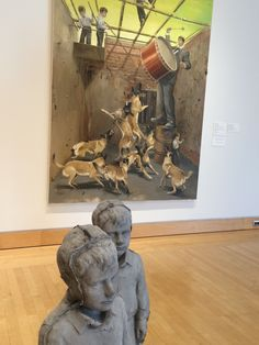 """Installation view of works by Jarmo Mäkilä. In his """"The Bow of Kings,"""" boys uniformly clad in white dress shirts and gray slacks appear to be going about spontaneous, unsupervised acts of play with the paradoxically grim determination of a military operation. Of the ceramic figures Mäkilä said """"boys are always looking out into the world. They are always in a pensive state, uncertain of their movement toward the future and uncertain of their relationship one to another."""""""