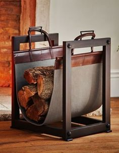 A sturdy iron frame and canvas-and-leather sling on Pottery Barn';s Industrial log carrier/holder make it both handsome and functional   archdigest.com