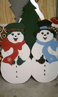 Wooden yard art! Snowman and snow lady! www.facebook.com/thewackywoodshop