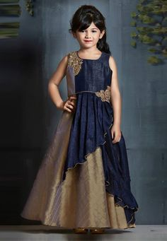 Buy Navy Blue Banarasi Readymade Embroidered Draped Gown 165443 online at lowest price from vast collection at Indianclothstore.com. Baby Girl Dresses Fancy, Kids Party Wear Dresses, Little Girl Pageant Dresses, Wedding Dresses For Kids, Fancy Gowns, Gowns For Girls, Girls Dresses, Kids Frocks Design, Kids Dress Patterns