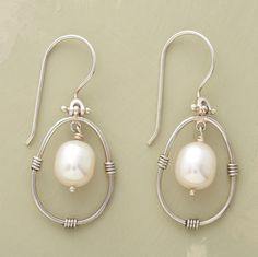 """Our handwrought sterling silver earrings with winsome white pearls swoon and sway to mesmerizing effect. Exclusive. 1-3/8""""L."""
