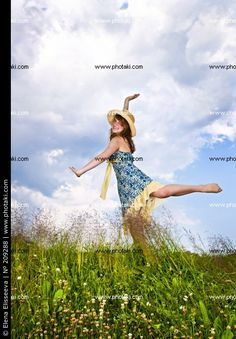 http://www.photaki.com/picture-girl-dancing-in-a-meadow-grass-natural_209288.htm