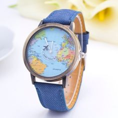 "Unisex Wanderlust travel watch.   The blue band is made of a soft ""denim"" type material with leather backing. Watch face about 1.5"" in diameter  World map background with a flying plane as the second hand.  Free shipping with tracking /  Purchased from Urban Outfitters  BRAND NEW"