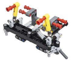 The  	LEGO Technic 42043 Mercedes-Benz Arocs 3245 has a steering system mounted on shock absorbers. Therefore a unique steering system that is very different than the standard rack steering in most Technic sets, based on the common rack and pinion setup, was needed. The photos of this steer axle suspension module here are from the second axle in the Mercedes-Benz Arocs 3245, since this is built first. 	If you look at the pictures above and below, you will see that the steering is con...