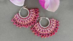 Pretty in pink, cranberry, berry and coral earrings feature: * Berry iris fringe beads * Coral, pink, berry and magenta seed beads * Silver filled 20mm leverback hoops Measure 2 at widest point, 1-1/2 long at longest point. ***Purchase arrives ready for gifting in an eco-friendly