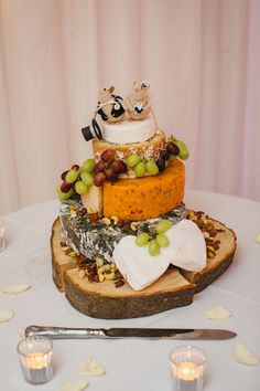 "This couple made an amazing ""cheese cake""; those mouse toppers are adorable!"