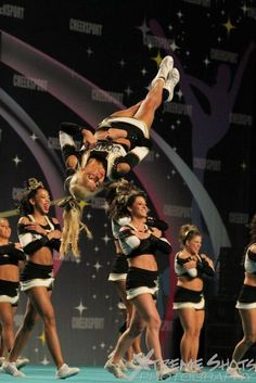 Why do cheerleaders cross their feet when twisting ? I have never heard a good reason for it. Cheer Stunts, Cheer Dance, Cheerleading, Cheer Fails, Cheer Routines, Cheer Picture Poses, Cheer Pictures, Figure Skating, Weight Lifting