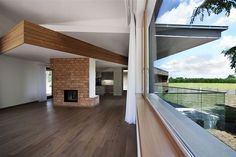Twin Houses by Ekler Architect  Interesting ceiling continues through the wall to the exterior