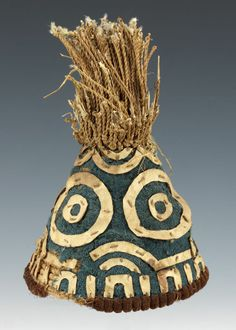 Africa   Man's hat, lapuum. Kuba People, DR Congo   Early 20th century     Raffia, strips of leather, wool trade cloth, traces of feathers   Hats of this style were reserved for senior titleholders or for the nyim (the paramount ruler)  This old example is powerfully graphic. Where the blue cloth is torn, the coiled structure of basketry is revealed.