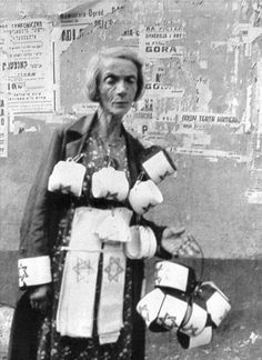 NEVER FORGET: Warsaw, Poland, A Woman Selling Armbands in the Ghetto Photographs Film and Photo Archive, Yad Vashem All rights reserved Warsaw Ghetto, Warsaw Poland, Poland Ww2, Jewish Ghetto, Holocaust Memorial, Jewish History, Persecution, Shows, Women In History